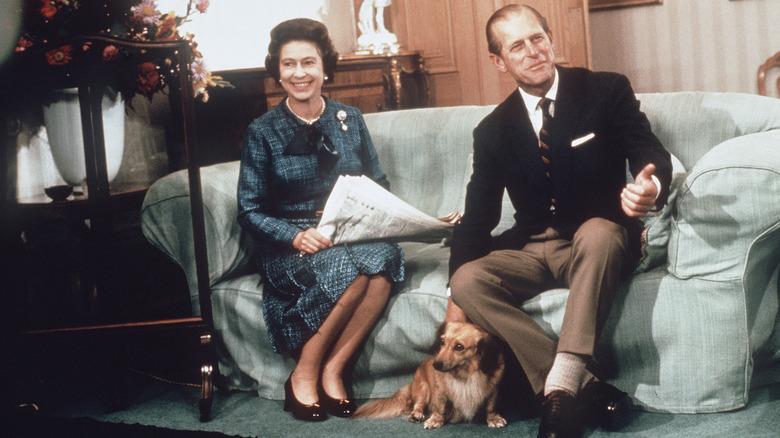 Queen Elizabeth II, Prince Philip and pet corgi dog