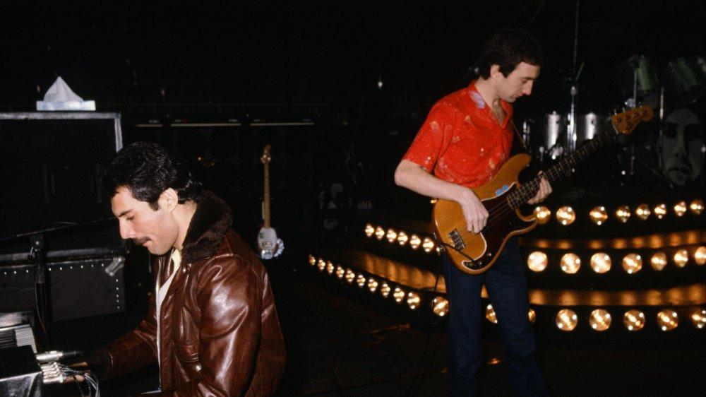 Freddie Mercury and John Deacon playing