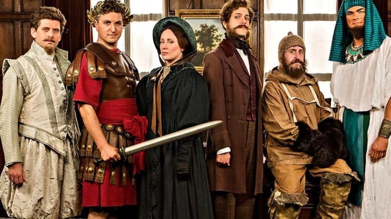 Cast of Horrible histories in various costumes