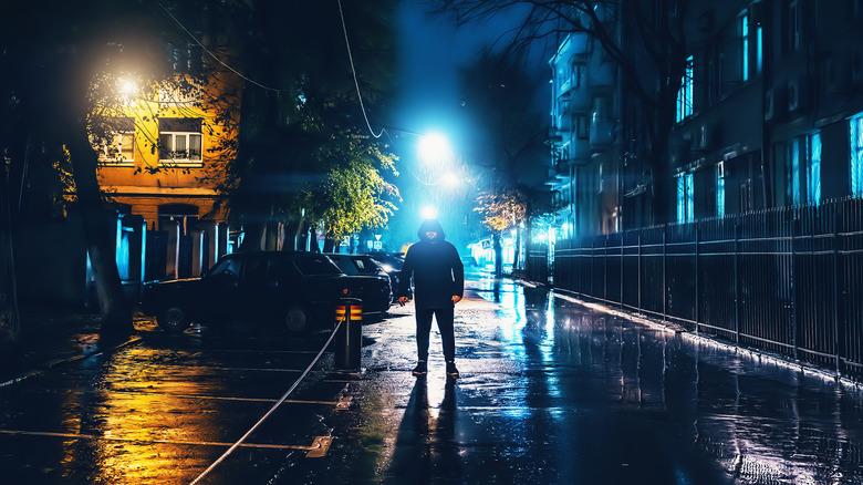 hooded man in shadows