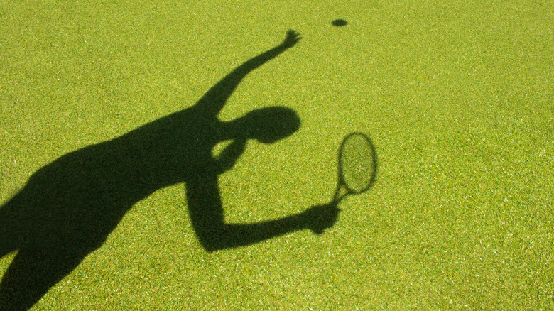 female tennis player in shadow