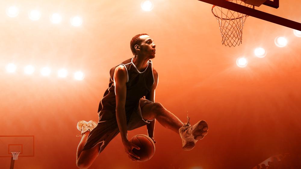 Dunking basketball player