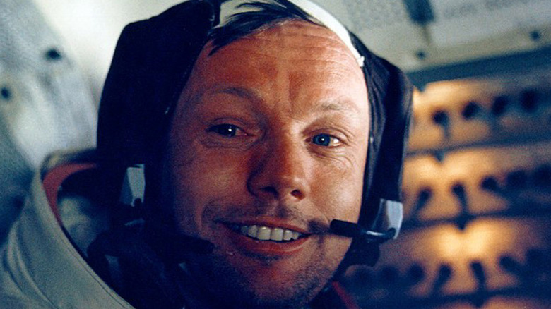 Neil Armstrong smiling in lunar module