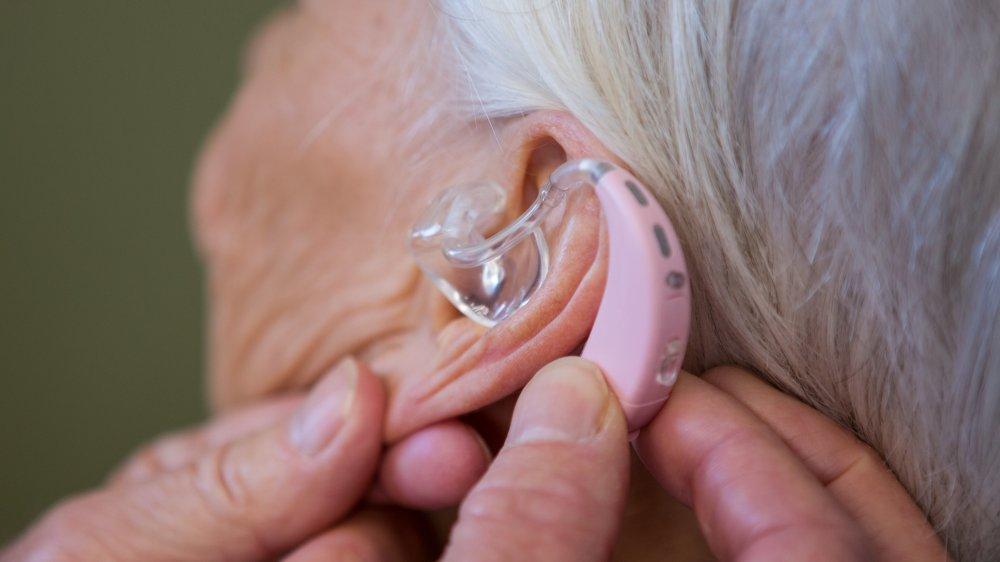 hearing aid elderly woman