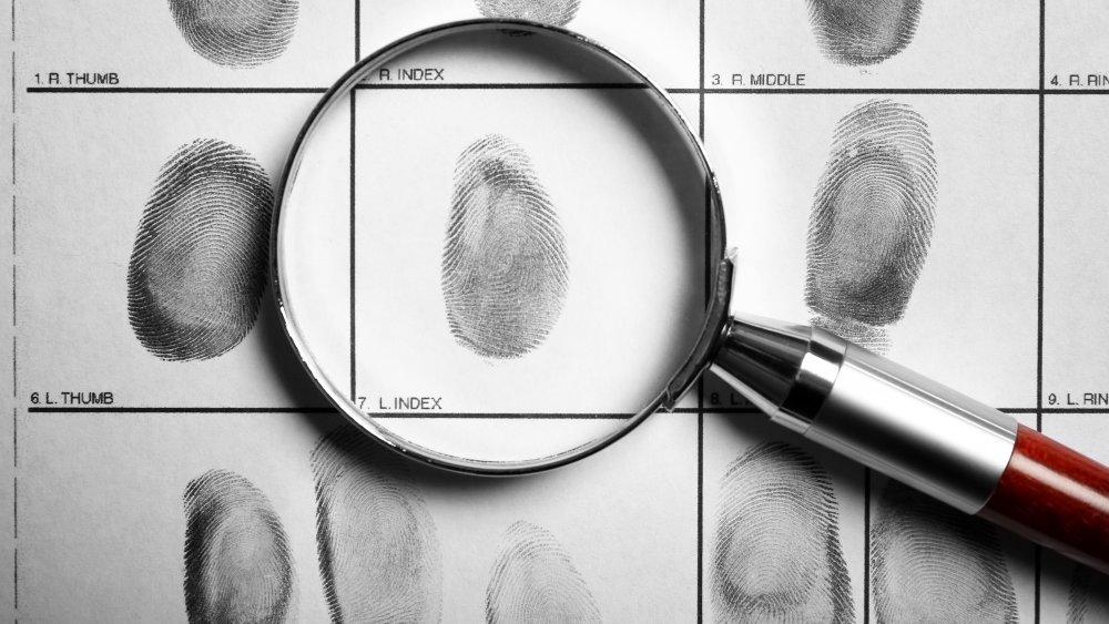 crime fingerprints magnifying glass