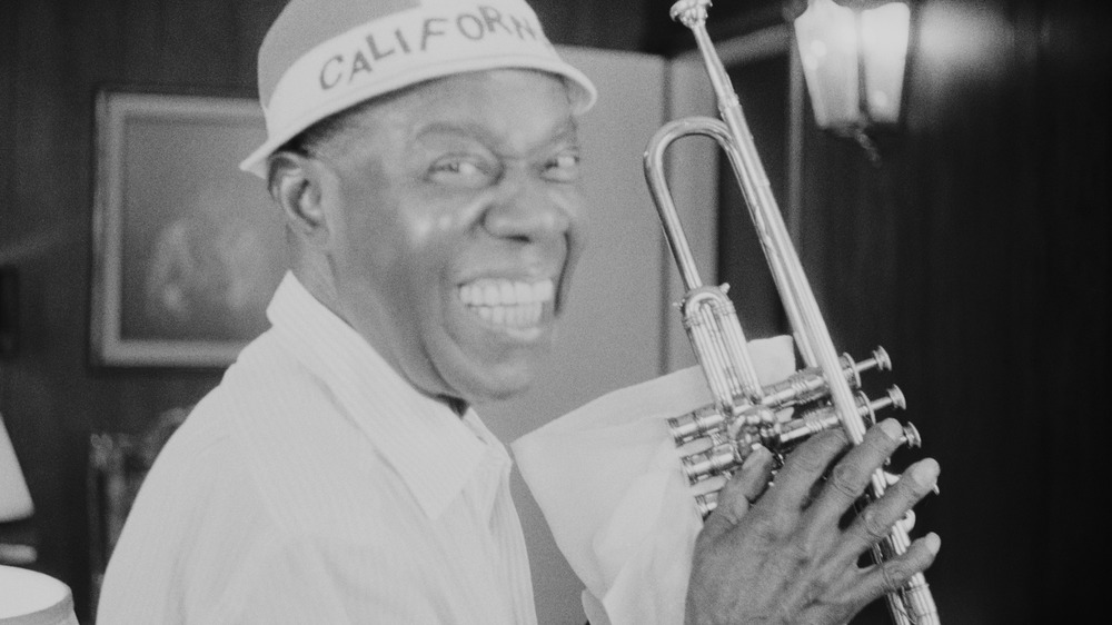 Jazz musician Louis Armstrong with a trumpet