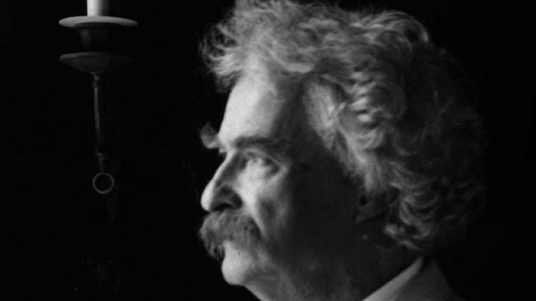 Mark Twain looking out window