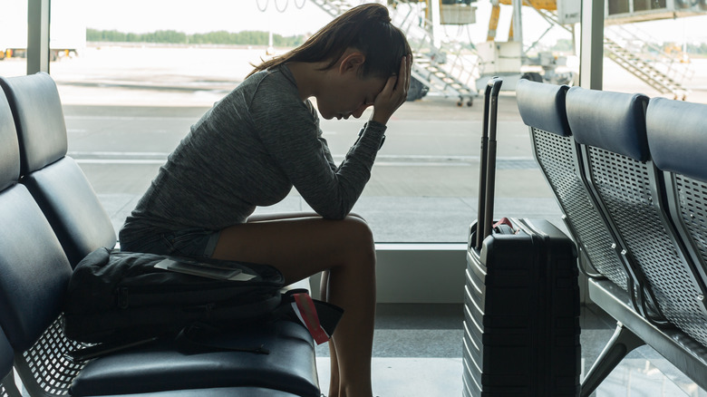 A tired woman waiting in an airport