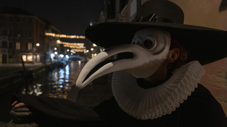 Person dressed as plague doctor