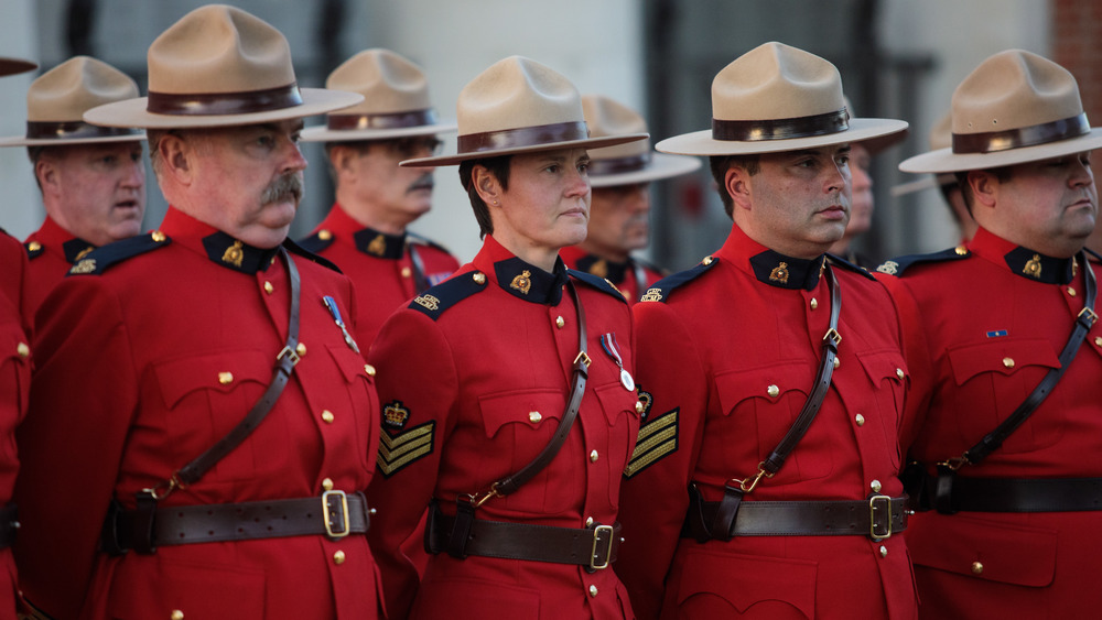 Canadian Mounties at attention