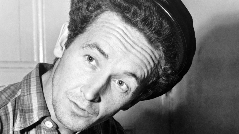Woody Guthrie with head cocked
