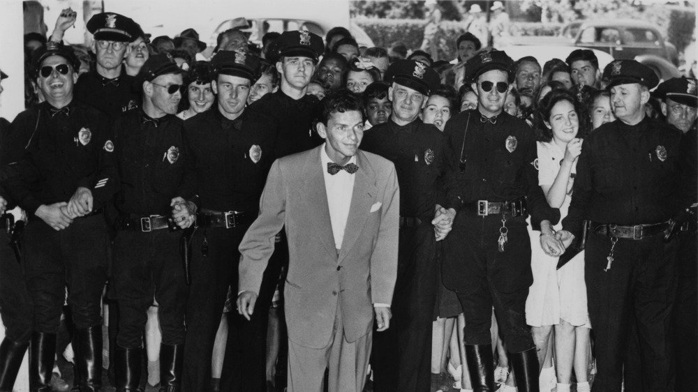 Frank Sinatra surrounded by police