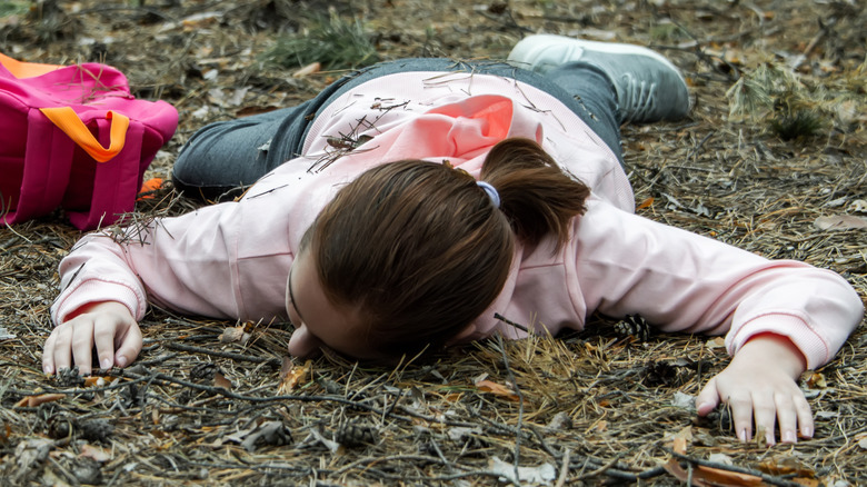 child passed out on ground