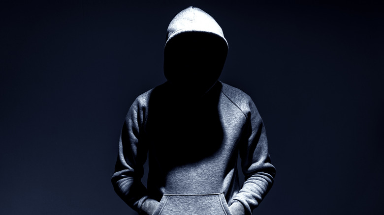a hooded figure
