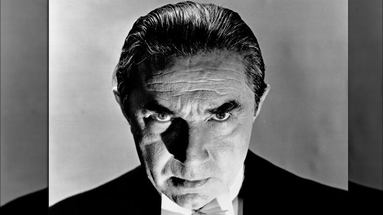 Bela Lugosi staring
