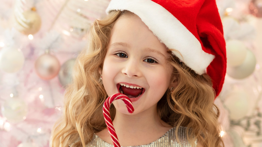 Child with candy cane