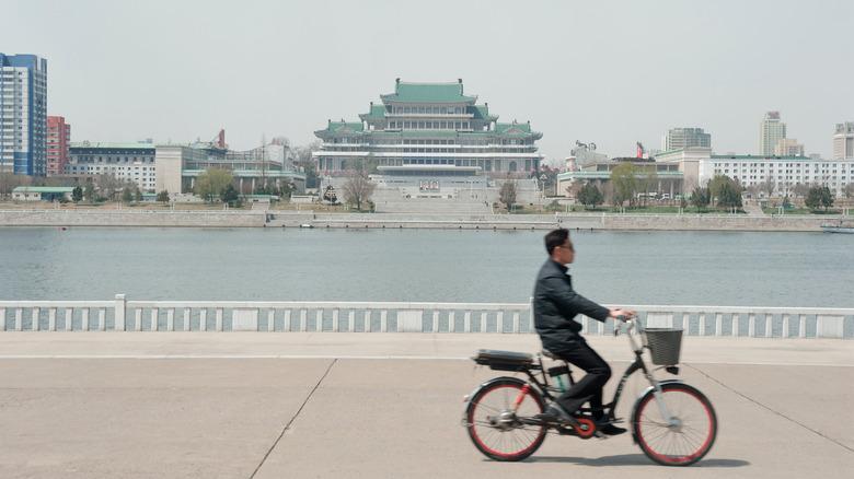 man on bicycle in Pyongyang