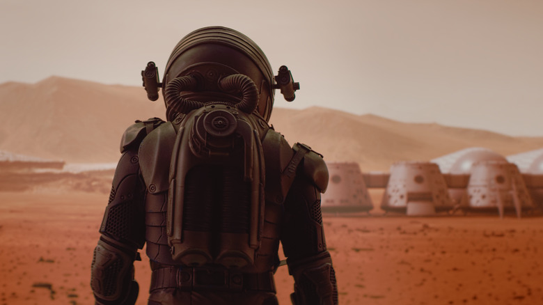 person in space suit on Mars