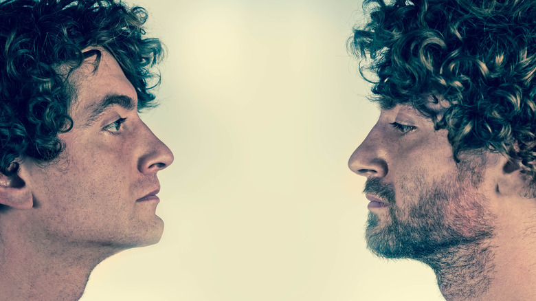 two men who look alike facing each other