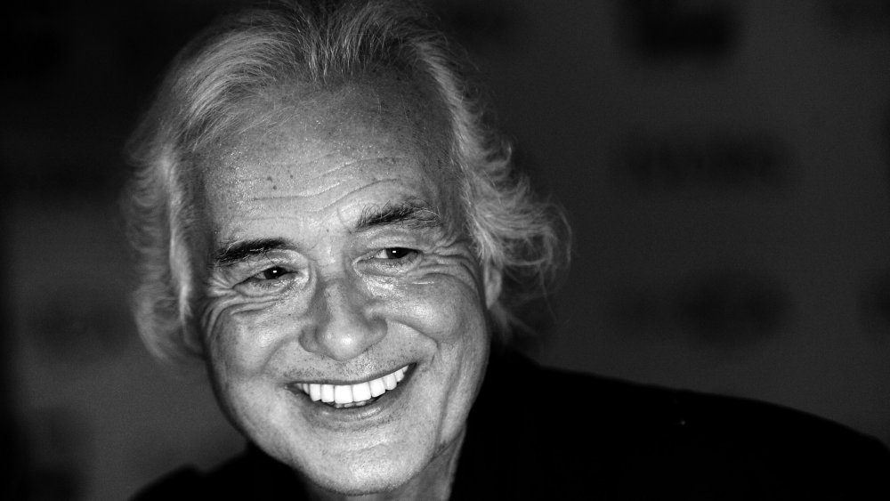 A close-up shot of Jimmy Page smiling